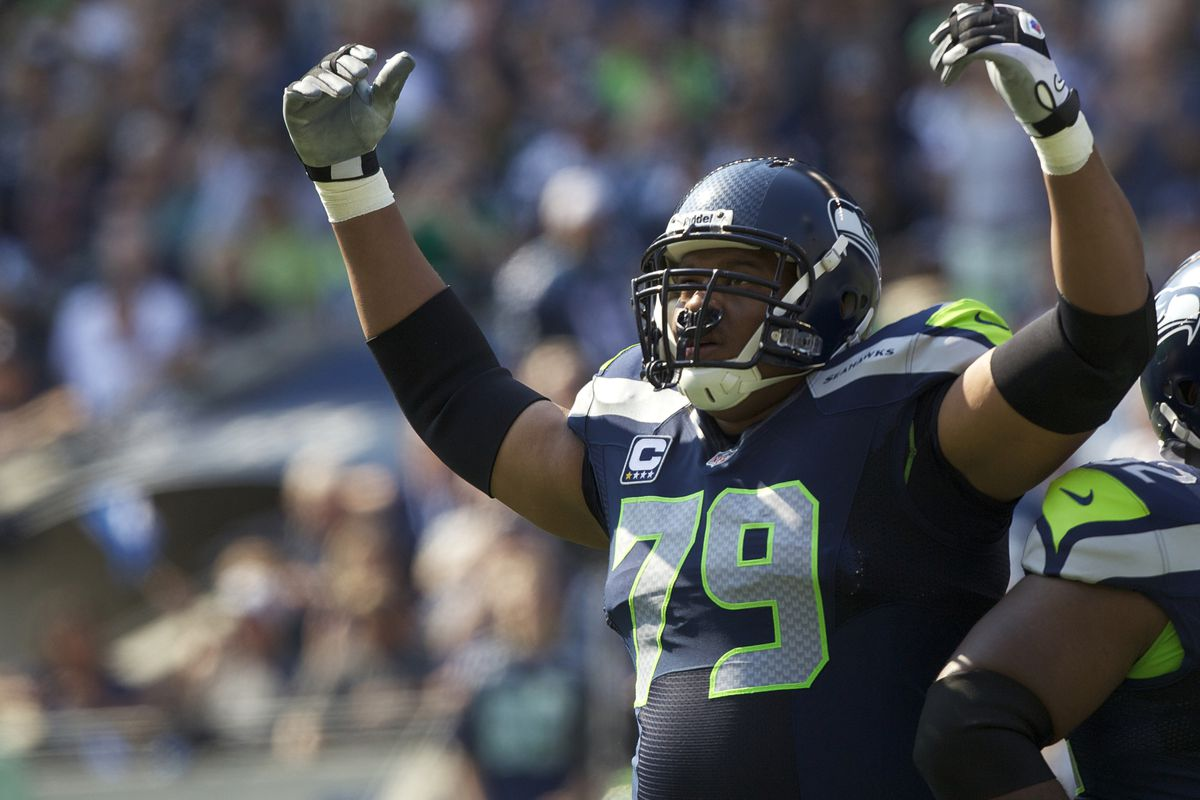 SEATTLE, WA - SEPTEMBER 16: Red Bryant #79 of the Seattle Seahawks gets the crowd involved during a game against the Dallas Cowboys at CenturyLink Field on September 16, 2012 in Seattle, Washington. (Photo by Stephen Brashear/Getty Images)
