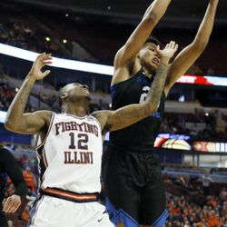 BYU forward Yoeli Childs, right, battles for a rebound against Illinois forward Leron Black during the first half of an NCAA college basketball game Saturday, Dec. 17, 2016, in Chicago. (AP Photo/Nam Y. Huh)