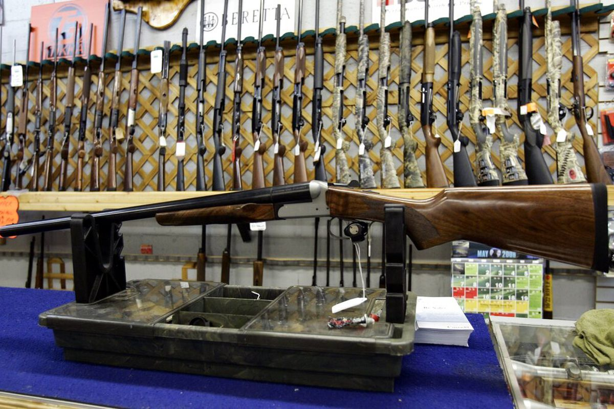 Rifles line a hunting store's shelves in Ottawa