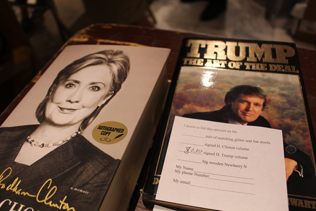 Book fair guests bid on signed copies of books by Hillary Clinton and Donald Trump. | Emily Moon/Sun-Times