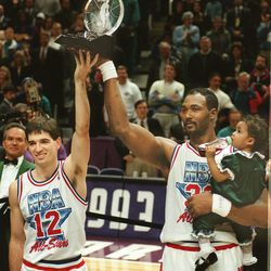 FILE: John Stockton and Karl Malone celebrate earning co-MVP honors in the 1993 NBA All-Star game on Feb. 21, 1993.