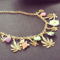 """We were diggin' this dope custom-made necklace by LA's <a href=""""http://www.jewelrybyveronique.com/"""">Jewelry by Veronique</a>. Teddybears, cannabis leaves, daisies...Wonder who it's for..."""