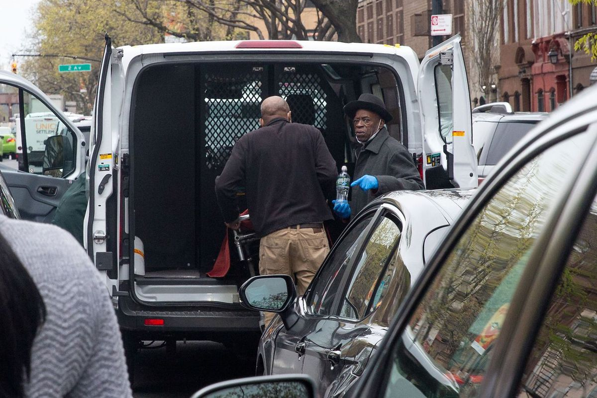 Workers at First Avenue Funeral Services in East Harlem load a stretcher into a U-Haul truck during the coronavirus epidemic.