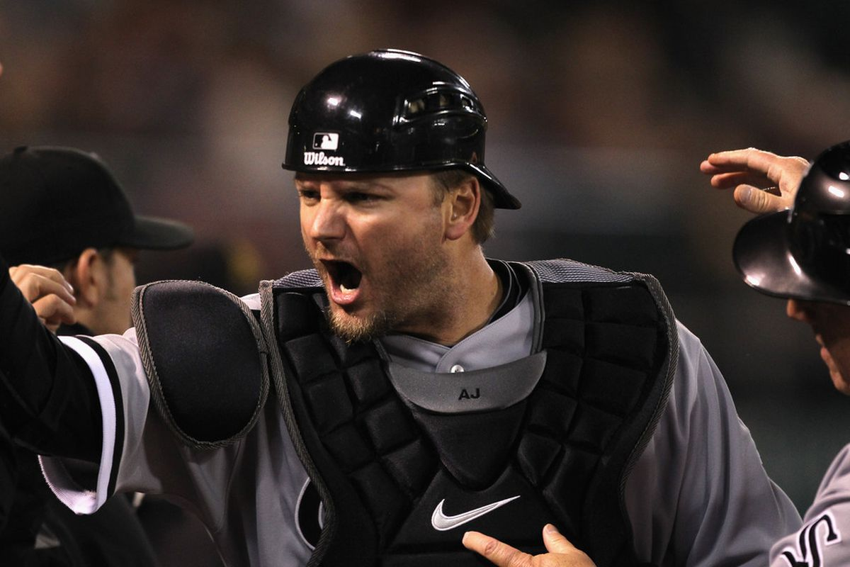 A.J. Pierzynski celebrates after tagging out Coco Crisp after an attempt steal of home on Friday, May 13.