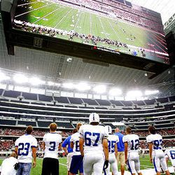 Bingham players stand on the sideline as the Miners play Euless (Texas) Trinity in the Kirk Herbstreit Varsity Football Series Monday at Dallas Cowboys Stadium in Arlington, Texas. Trinity won 42-21.
