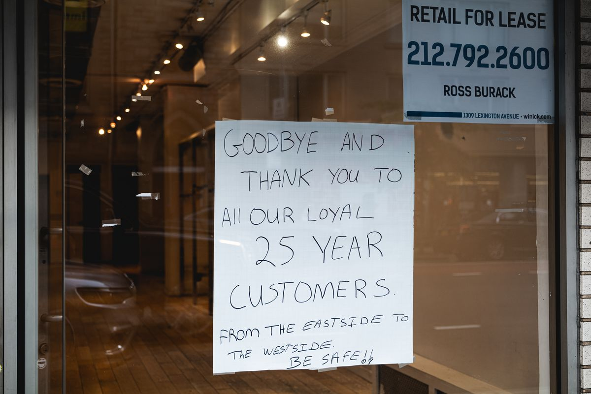 """Photo of a handwritten sign on a store window that says, """"Goodbye and thank you to all our loyal 25 year customers from the Eastside to the Westside be safe!!"""""""