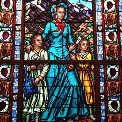 A stained-glass window pays tribute to the pioneers.