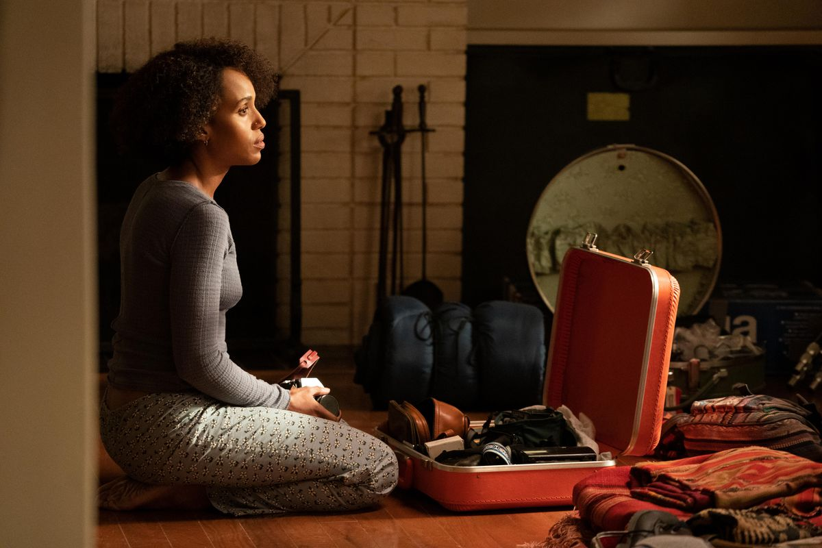 mia seated and unpacking a suitcase