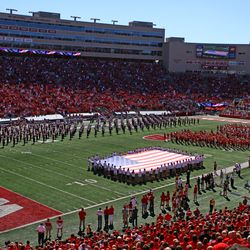 The Wisconsin Alumni Band plays the national anthem before kickoff.