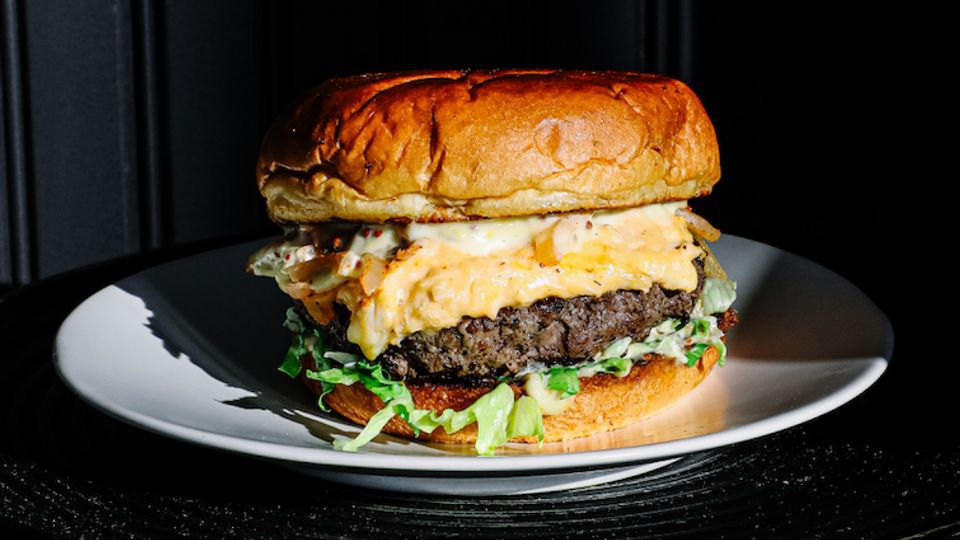 The AJ burger from ABC Pony has crab dip and Old Bay onions