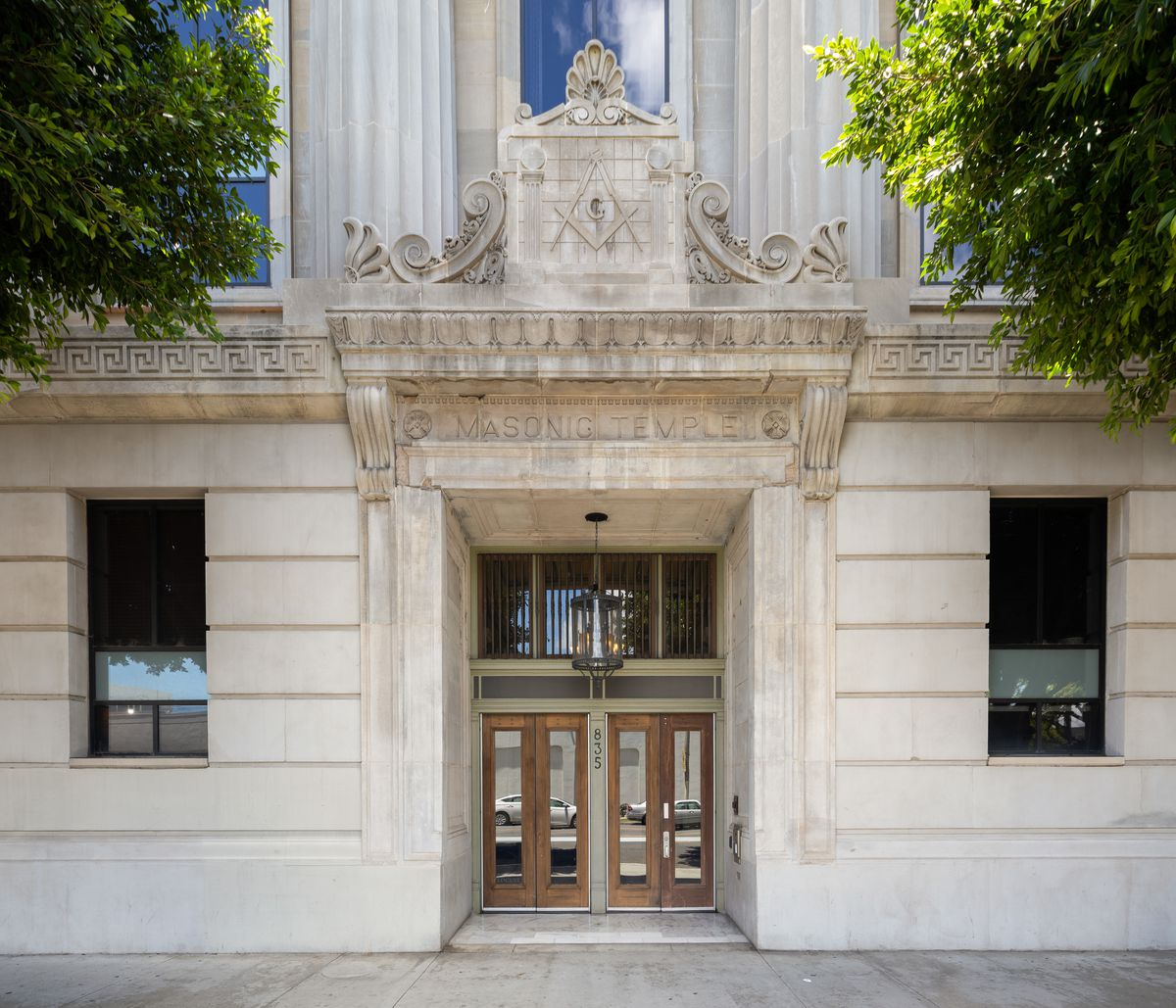 """Double doors framed by a stone entryway with the words """"Masonic Temple."""""""
