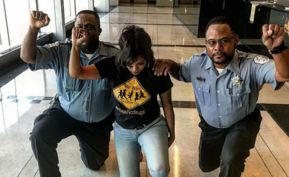 """An Instagram account photo of two Chicago Police officers, along with a woman believed to be Aleta Clark, an anti-violence activist in Englewood, """"taking a knee."""" 