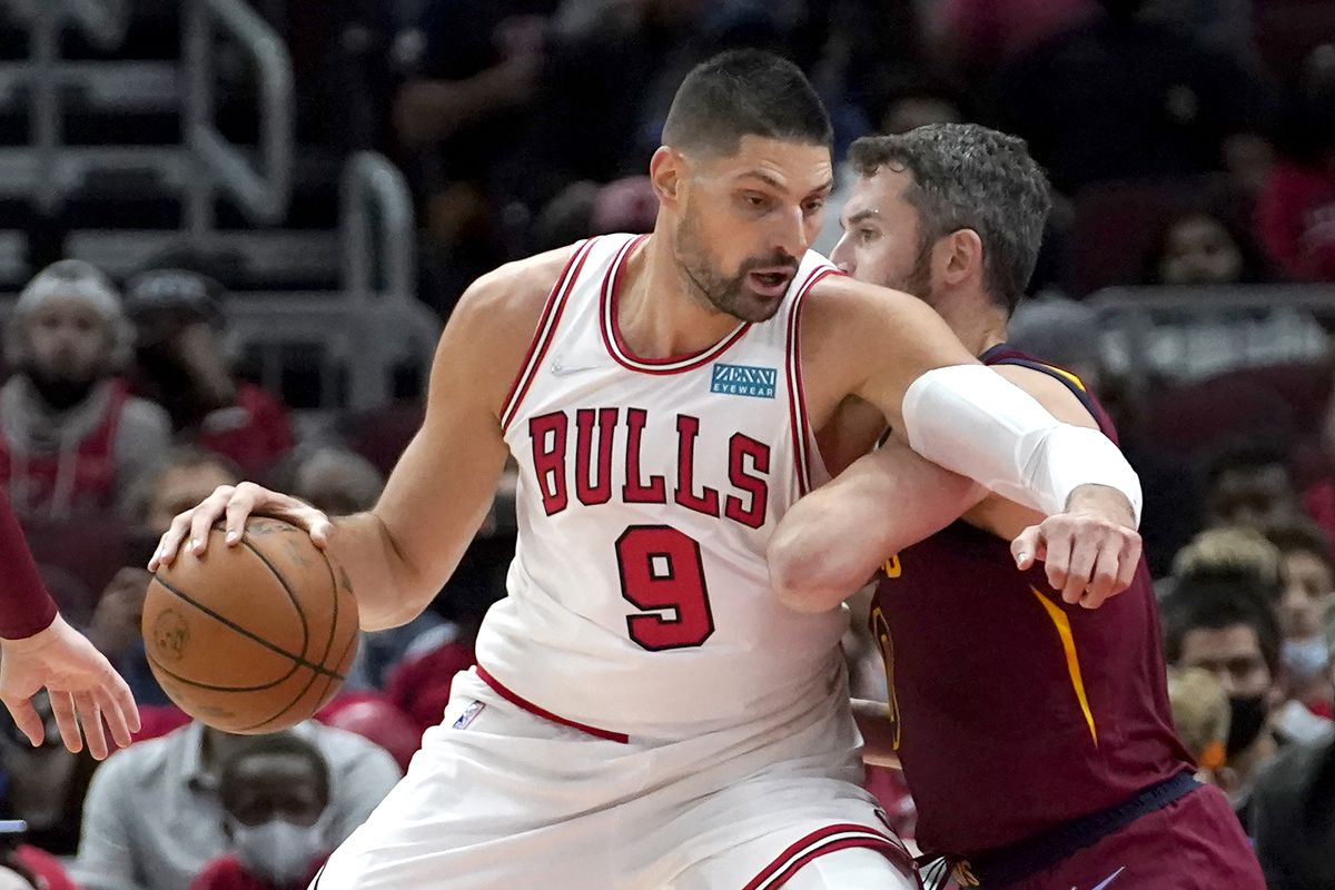 The Bulls' Nikola Vucevic pushes up against the Cleveland Cavaliers' Kevin Love during Tuesday's preseason game.