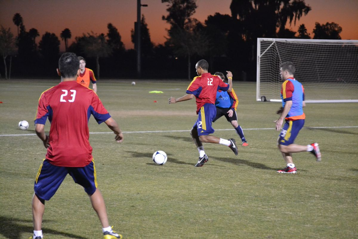 Ive Burnett, on the ball, is a former academy standout who has trained with Real Salt Lake.