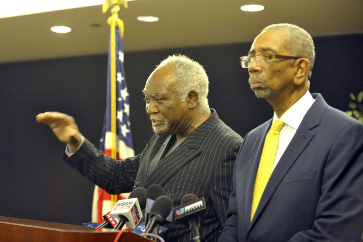 Congressmen Danny K. Davis, left, and Bobby Rush speak at a news conference in 2012.