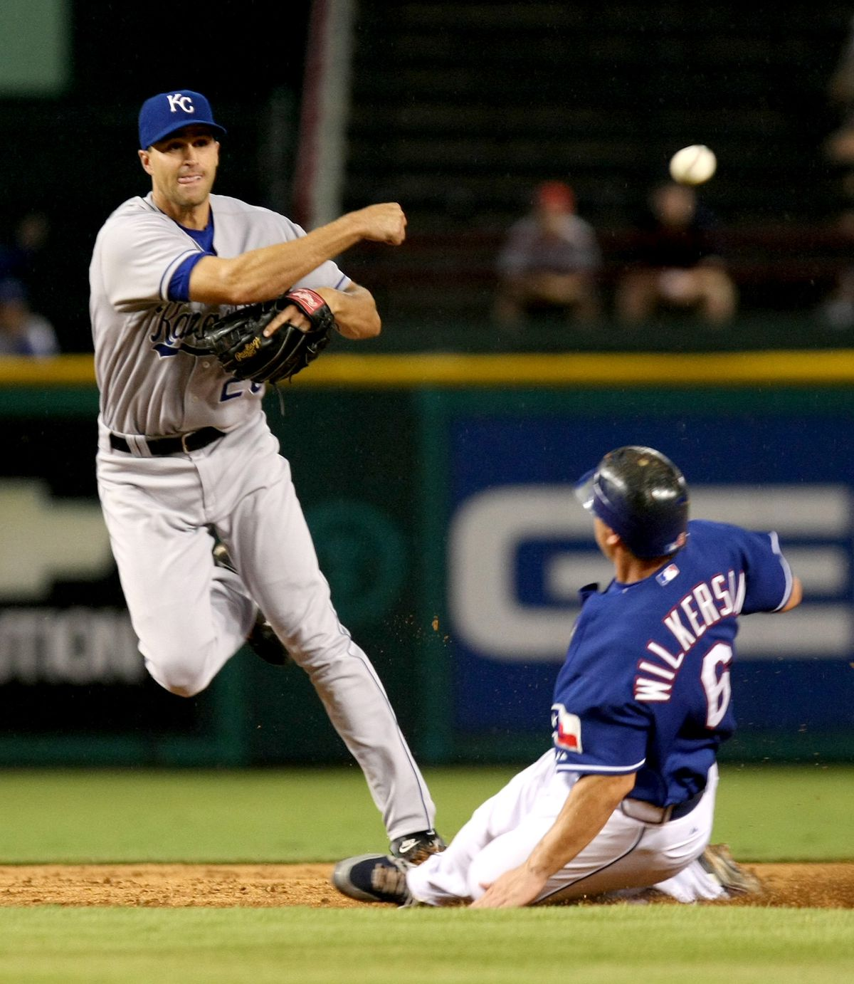 Kansas City Royals' Jason Smith tags out Texas Rangers' Brad Wilkerson and throws to first for an attempted double play in the third inning at Rangers Ballpark in Arlington, Texas, Tuesday, September 4, 2007.