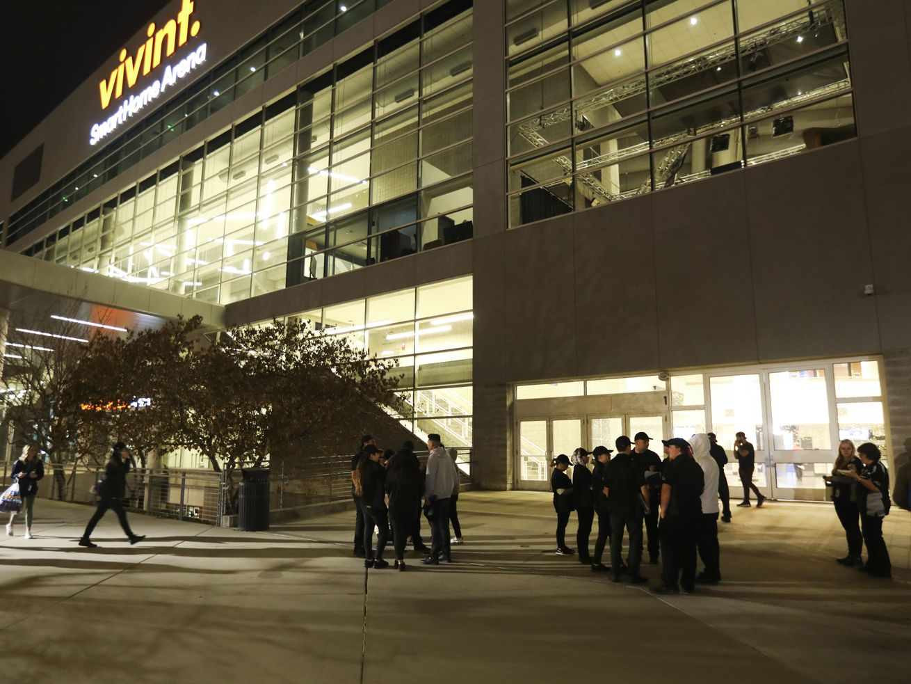 Employees stand outside the Vivint Smart Home Arena after being evacuated in Salt Lake City on Friday, Nov. 22, 2019.