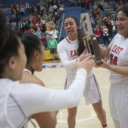 East's Liana Kaitu'u and Lani Taliauli celebrate with teammates following the Leopards' 68-48 victory against Timpview in the Class 5A state championship game at Salt Lake Community College in Taylorsville on Saturday, Feb. 24, 2018.