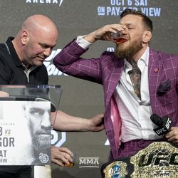 Conor McGregor drinks his Proper No. 12 Irish whiskey Thursday at the UFC 229 press conference in New York at Radio City Music Hall.