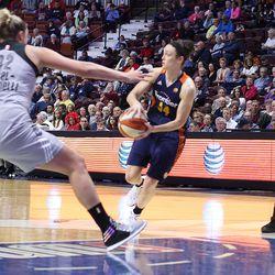 Connecticut Sun's Kelly Faris (34) makes a pass in front of San Antonio Stars' Jayne Appel-Marinelli (32).