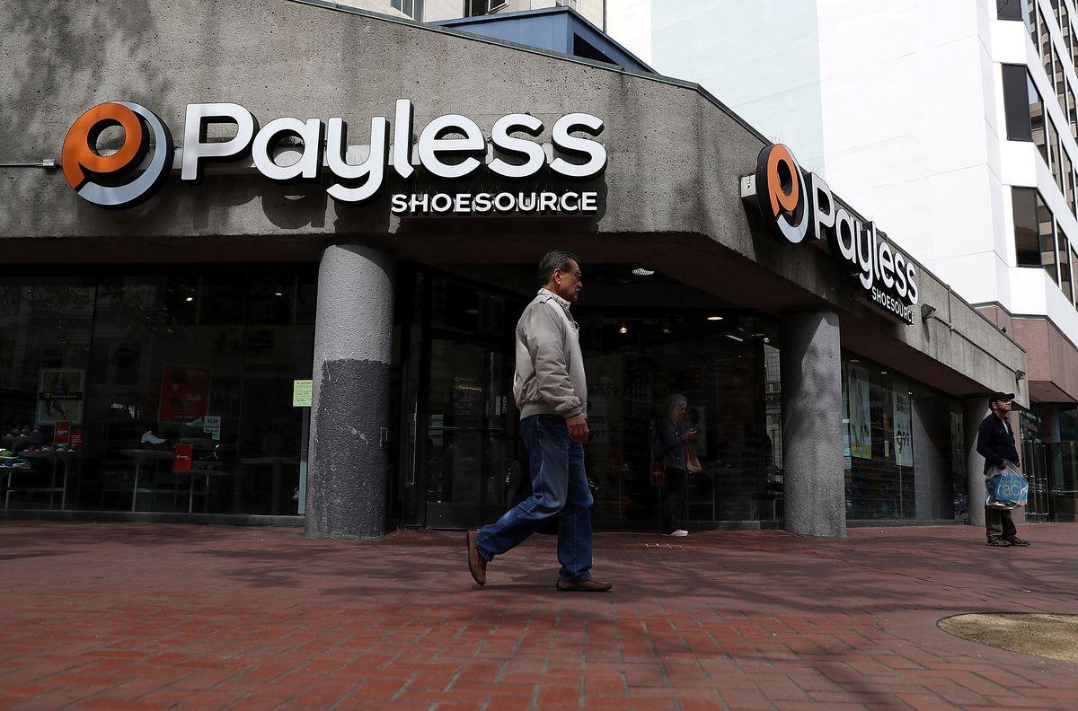 6df9fb3a2  nbsp A pedestrian walks by a Payless Shoe Source store on April 5