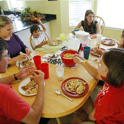 The Keel family sits down to dinner. Burgandy Keel says the family makes it a priority to eat dinner together.