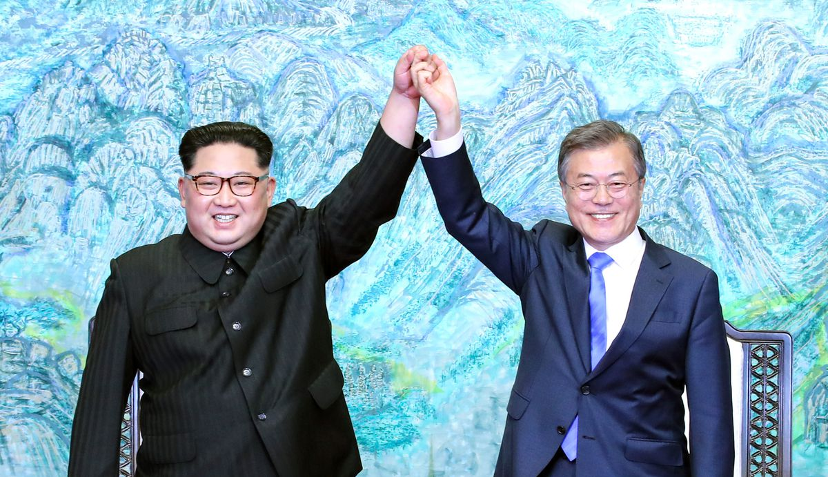 North Korean leader Kim Jong Un and South Korean President Moon Jae-in celebrate ahead of their talks during a historic summit on April 27, 2018.