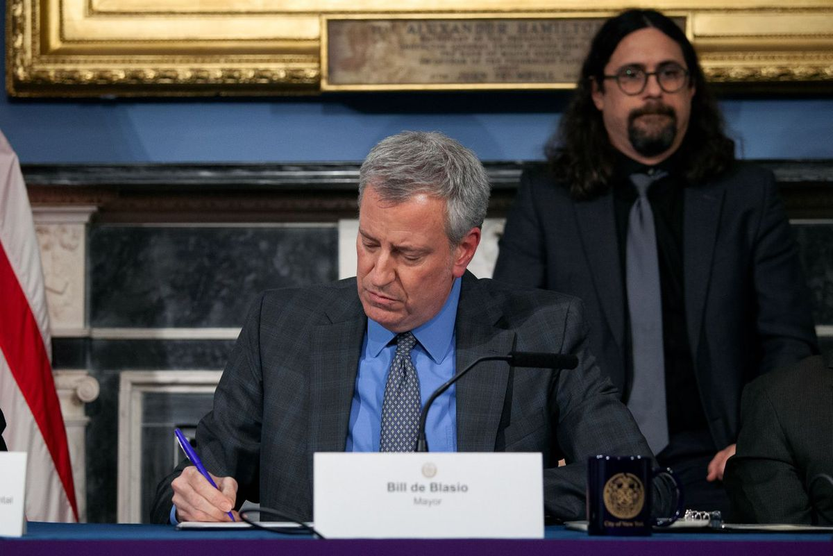 Mayor Bill de Blasio signs an executive order at City Hall declaring a state of emergency for the city in response to the coronavirus.