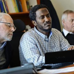Yonas Fikre, center, a Portland, Oregon Muslim American talks to media with his U.S. attorney Thomas Nelson, left, and Swedish lawyer Hans Bredberg, right, in Stockholm, Sweden, April 18, 2012. After a 2010 trip to visit family in Khartoum, Sudan,  Fikre claims to have been detained and tortured. Put on a FBI no-fly list,  Fikre is now unable to return home to the U.S.