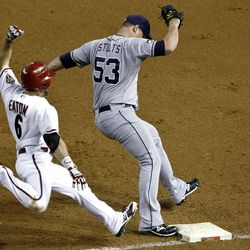 San Diego Padres' Eric Stults (53) beats Arizona Diamondbacks' Adam Eaton (6) to first base for the out in the fourth inning of a baseball game Tuesday, Sept. 18, 2012, in Phoenix.