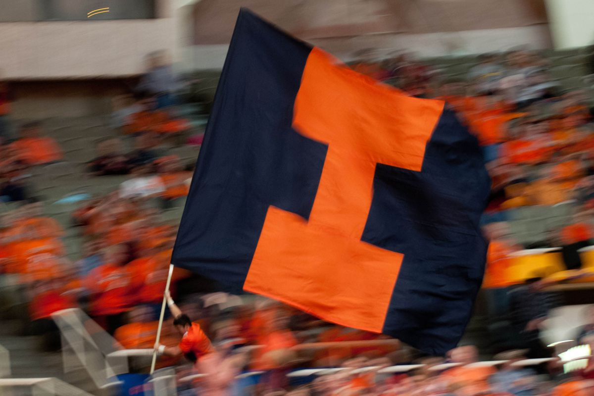 Illinois doesn't have a mascot, so here's a cheerleader running with a giant flag.