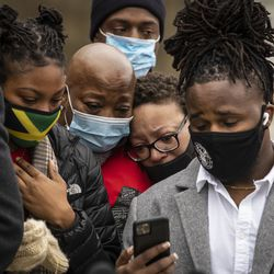 Family members and supporters cry while watching Tafara Williams speak to reporters from her hospital bed via a video conference call during a press conference outside Waukegan's city hall complex, Tuesday morning, Oct. 27, 2020. Williams, 20, was wounded and her boyfriend, 19-year-old Marcellis Stinnette, was killed when they were both shot by a Waukegan police officer on Oct. 20.
