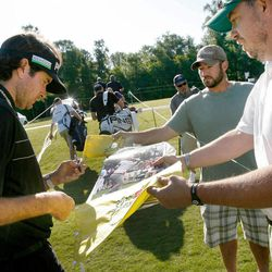 Frank Davis, right, of Madison, Miss., gets an autograph from Masters Champion and defending Zurich Classic champion Bubba Watson, left, on Wednesday, April 25, 2012, during the pro-am for the Zurich Classic golf tournament at TPC Louisiana in Avondale, La.