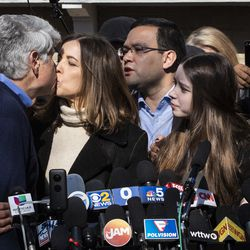 Former Illinois Gov. Rod Blagojevich kisses his wife, Patti Blagojevich, as their two daughters,Annie(left) and Amy, look on during a news conference outside the family's Ravenswood Manor home the day after he was released from a Colorado prison, Wednesday afternoon, Feb. 19, 2020. President Donald Trump on Tuesday commuted Blagojevich's 14-year prison sentence on charges of public corruption.