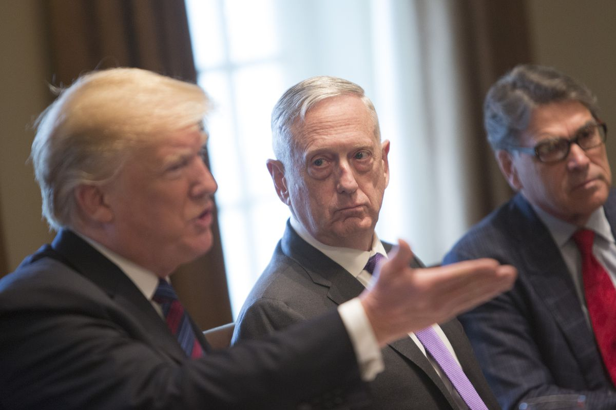 President Donald Trump speaks at a meeting at the White House as Defense Secretary Jim Mattis and Energy Secretary Rick Perry look on.