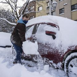 Michael Svabek digs out his car Tuesday in the Edgewater neighborhood.