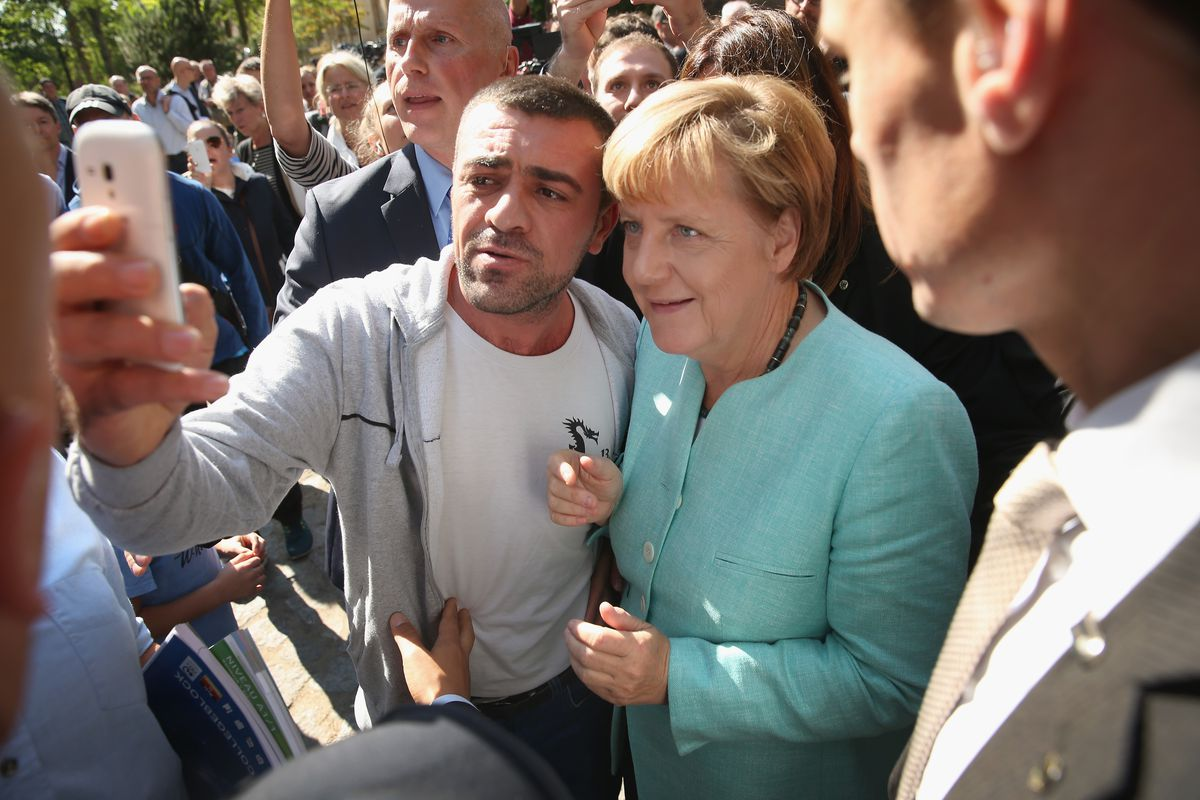 Germany's chancellor spent an afternoon with refugees in Berlin.