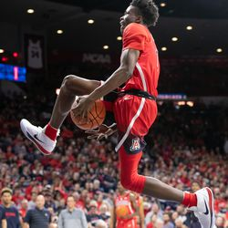 Devonaire Doutrive slips the ball between his legs before a big slam during the 2018 Red-Blue dunk contest in McKale Center on October 14 in Tucson, Ariz.