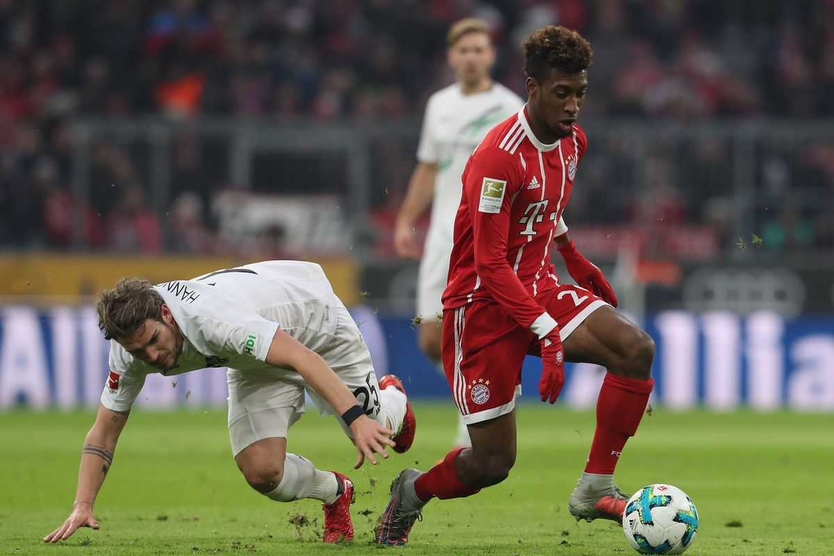 MUNICH, GERMANY - DECEMBER 02:  Kingsley Coman (R) of FC Bayern Muenchen fights for the ball with Oliver Sorg of Hannover 96 during the Bundesliga match between FC Bayern Muenchen and Hannover 96 at Allianz Arena on December 2, 2017 in Munich, Germany.  (Photo by A. Beier/Getty Images for FC Bayern)