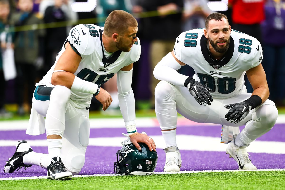 Philadelphia Eagles tight end Zach Ertz and tight end Dallas Goedert talk before the start of a game against the Minnesota Vikings at U.S. Bank Stadium.