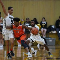 Brother Rice's Marquise Kennedy (24) makes his way around Richard's Anthony Taylor (5), Tuesday 02-19-19. Worsom Robinson/For the Sun-Times.