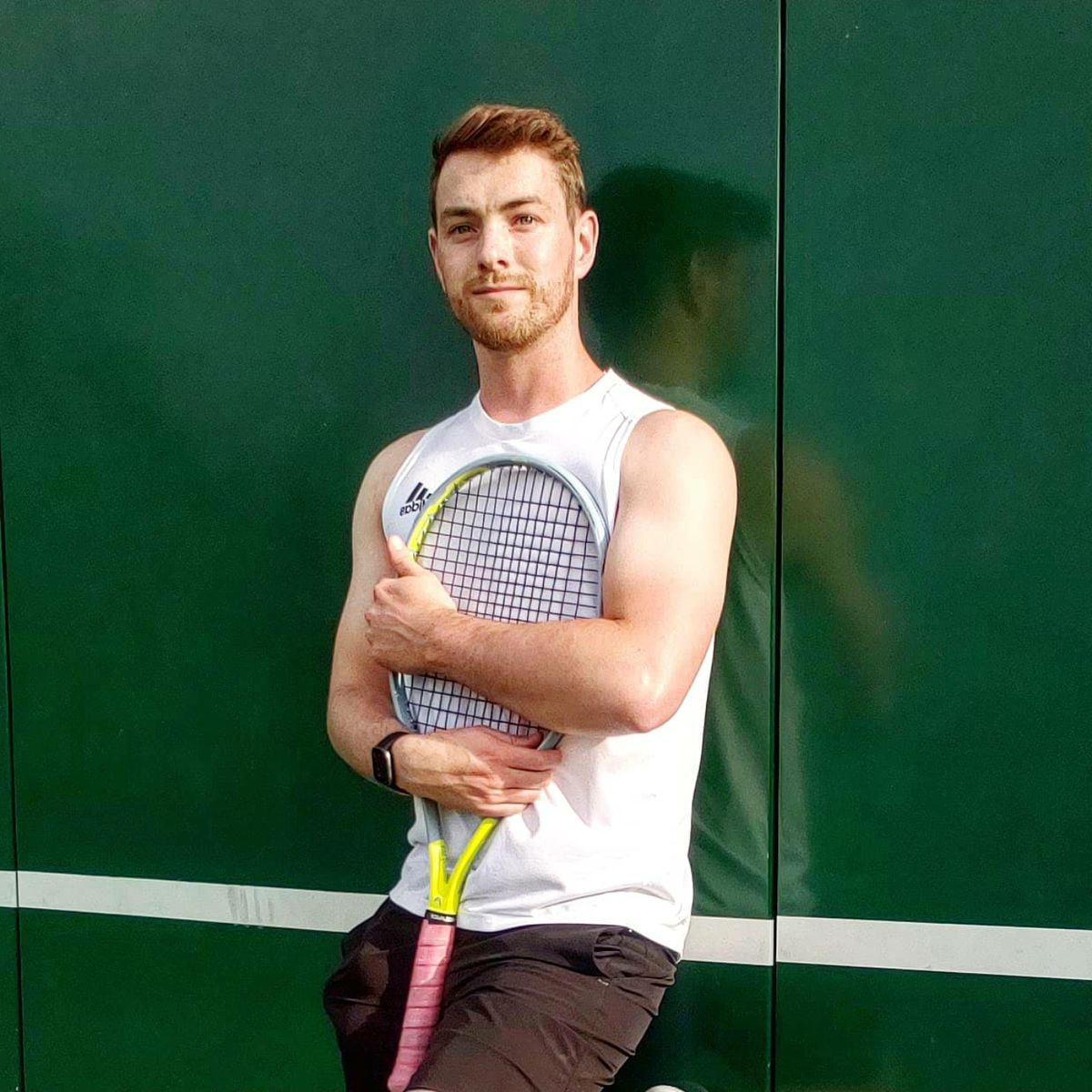 Scott Strough holding a tennis racket.