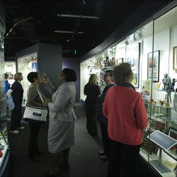 In a March 14, 2012 photo, visitors look over displays at the Jim Crow Museum of Racist Memorabilia in Big Rapids, Mich. The museum says it has amassed the nation?s largest public collection of artifacts spanning the segregation era, from Reconstruction until the civil rights movement, and beyond. (AP Photo/Carlos Osorio)