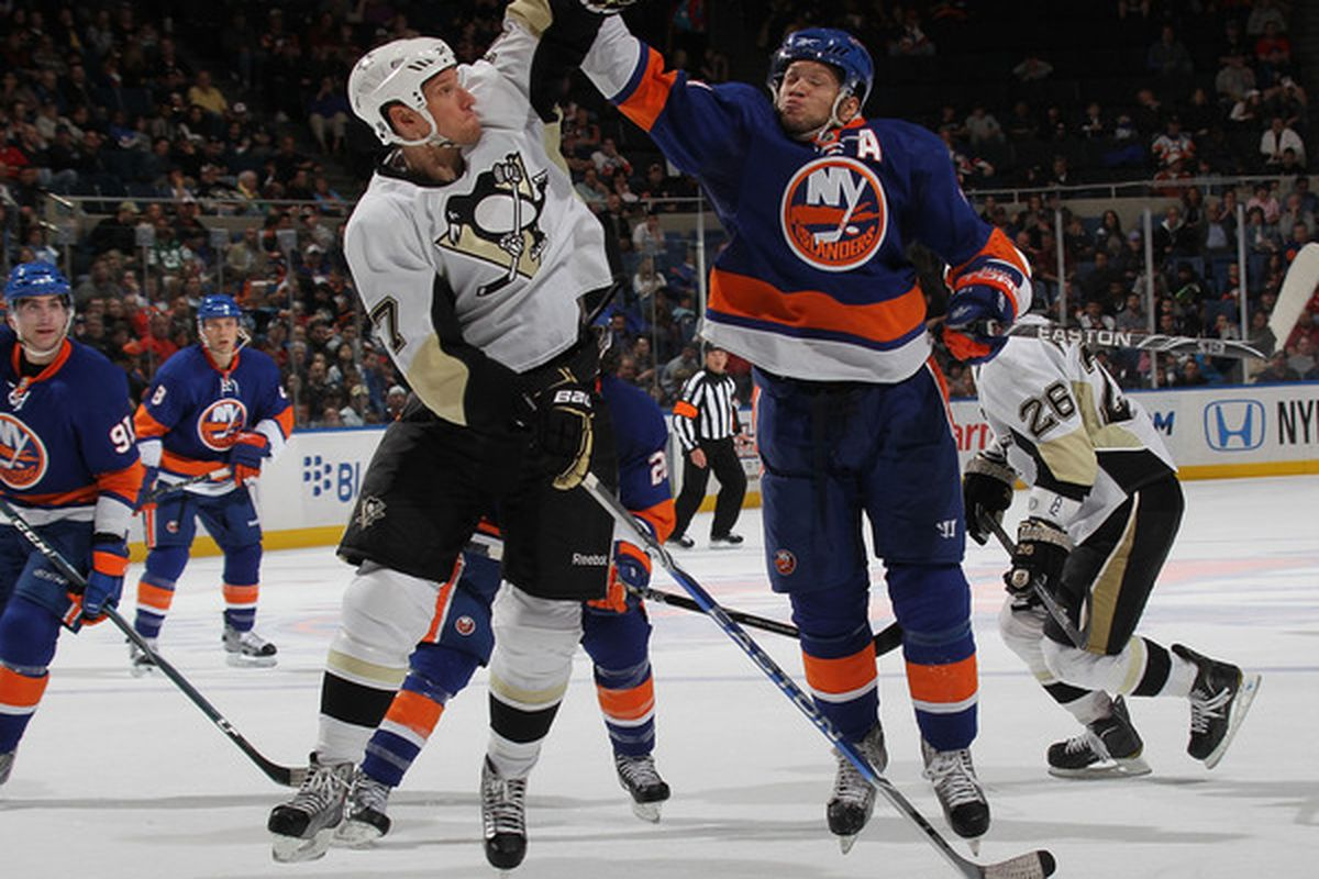 In a moment of sport confusion, Kyle Okposo and Mark Eaton go up for a jump puck.
