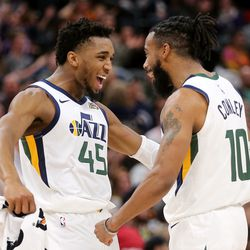 Utah Jazz guard Donovan Mitchell (45) and Utah Jazz guard Mike Conley (10) celebrate after a Conley 3-point shot as the Utah Jazz and the Sacramento Kings play an NBA basketball game at Vivint Smart Home Arena in Salt Lake City on Saturday, Jan. 18, 2020. Jazz won 123-101.