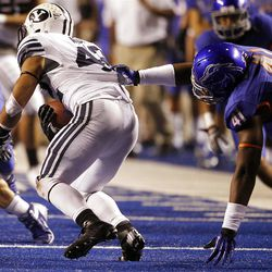Michael Alisa of the Brigham Young Cougars tries to pull away from Kharyee Marshall of the Boise State Broncos during NCAA football in Boise, Thursday, Sept. 20, 2012.