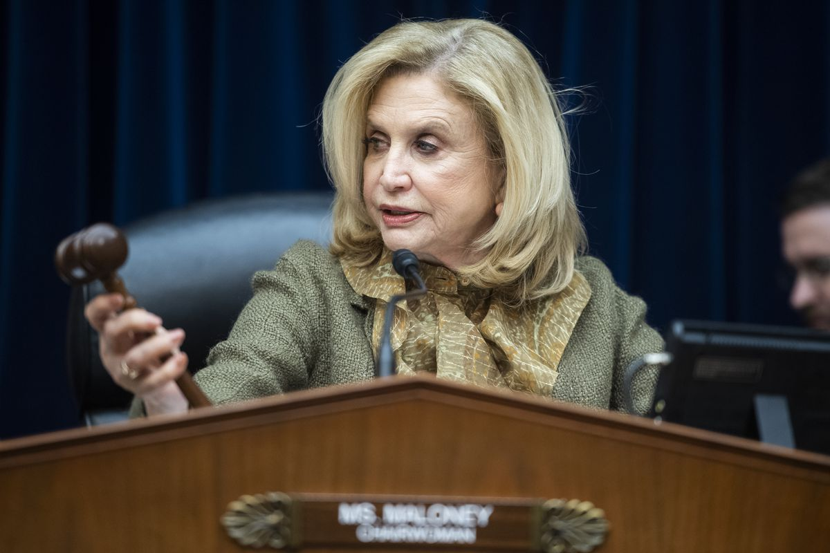 U.S. Representative Carolyn Maloney sits behind a dais, conducting a House Oversight and Reform Committee hearing