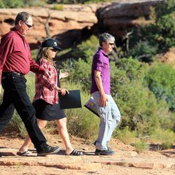 Dave Ure, executive director of the Utah School and Institutional Trust Lands Administration, and Ashley Korenblat walk with Interior Secretary Sally Jewell as she visits Canyon Country in southern Utah on Thursday, July 14, 2016. During her trip to the region, she said she was shocked by the lack of protection for Native American cultural sites. Today, President Barack Obama declared the Bears Ears National Monument in southeast Utah.