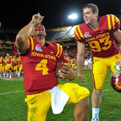Iowa State Cyclones quarterback Austen Arnaud (4) and center Sam Anker (93) celebrate their 14-13 victory over the Minnesota Golden Gophers in the 2009 Insight Bowl at Sun Devil Stadium.
