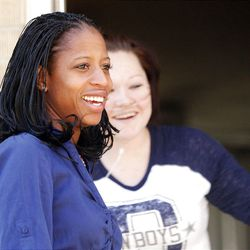 Candidate Mia Love, left,   laughs with Shelby Snyder-Warenski as she walks door to door in West Valley City on Friday, Nov. 2, 2012.